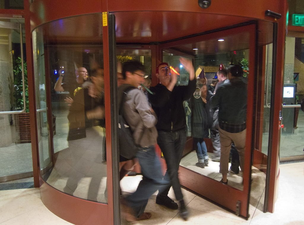 These revelers could stand to be reminded of some of the dangers of revolving doors