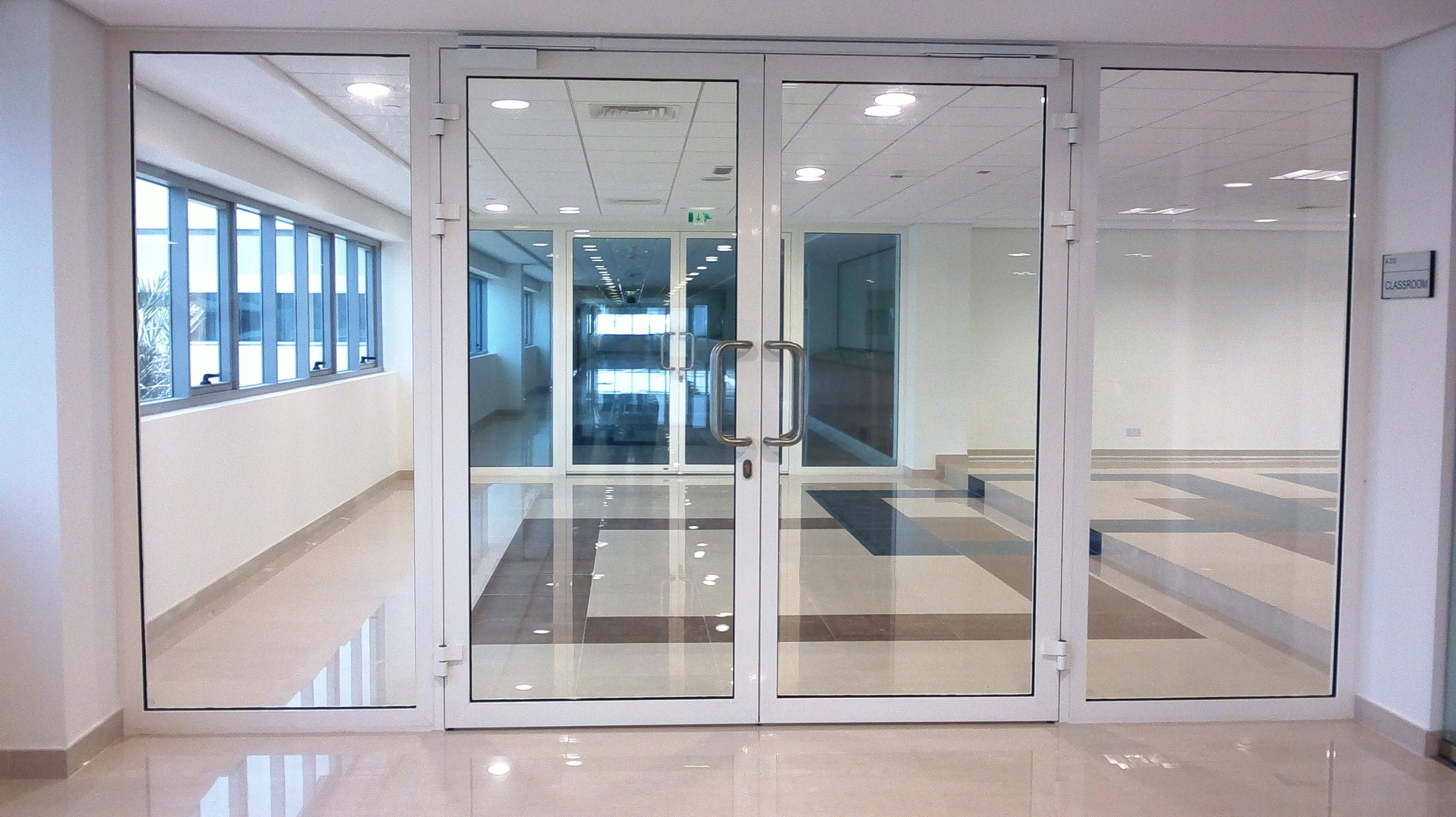 What is the cost of installing automatic sliding and swing for Office front door design